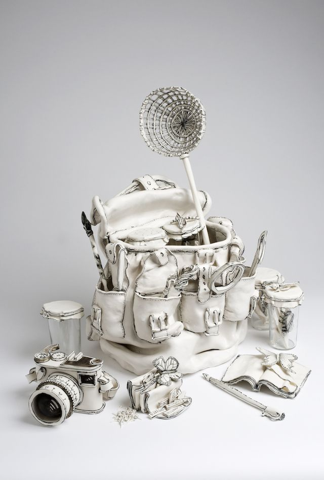 3D artwork by Katharine Morling, the English artist who do white #sculptures in porcelain and ceramic of still-life objects. Here we have backpack, #camera and much more stuff