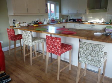 These floral covers for bar stools really make them stand out in the background. Very Danish.