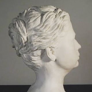 Classical me. Self-portrait sculpture seen from the side. Plaster of Paris cast from a clay original.  #ArtbyCarinaturckclark #art #sculpture #plaster #clay #classic #face #portrait #selfportrait #hair #hairstyle