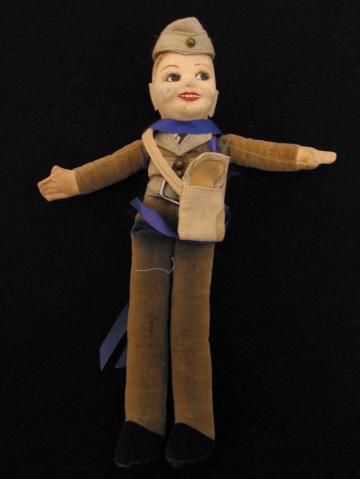 Royal Air Force doll carried as a mascot and good luck charm by pilot Flying Officer Jack Arthur Hoffeins. The purples ribbon from Jack's Memorial Cross is tied around the doll. From the collection of the Air Force Museum of New Zealand.