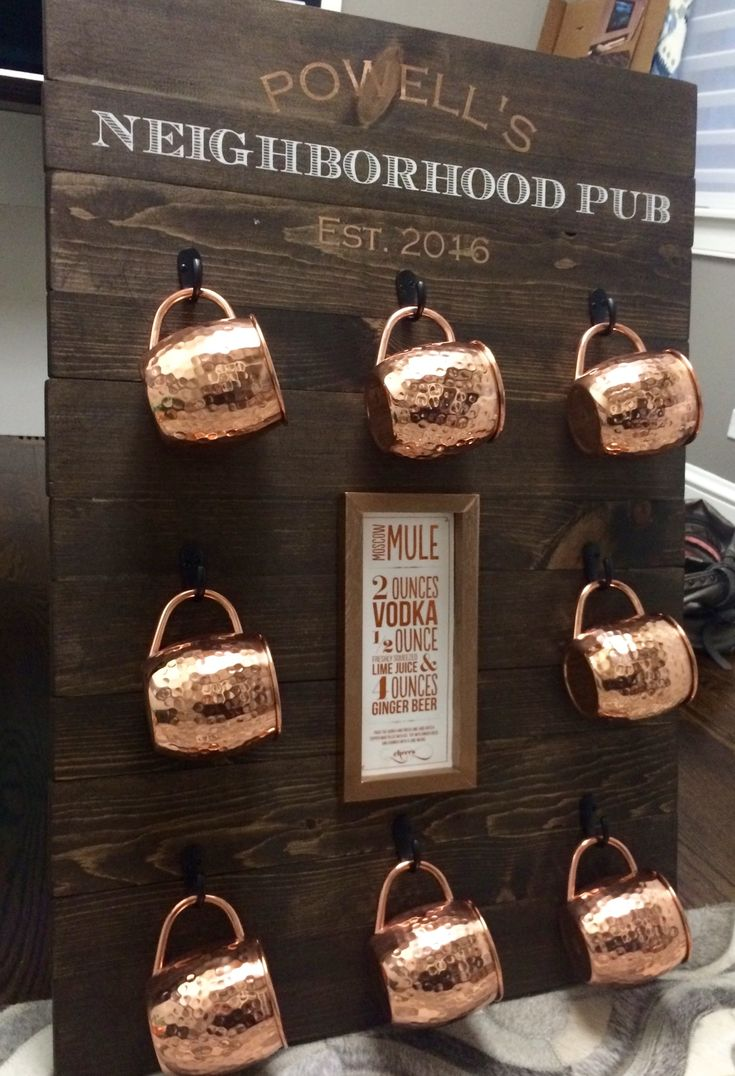 Custom wood sign to hold copper moscow mule mugs! So cool!