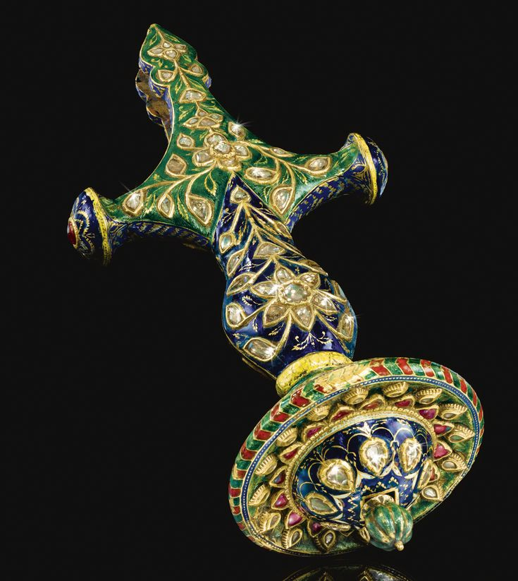 A FINE MUGHAL ENAMELLED TALWAR HANDLE SET WITH DIAMONDS AND RUBIES, JAIPUR, NORTH WEST INDIA, 18TH/19TH CENTURY
