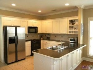 Baton Rouge Apartments  : Choose Your Location: Inspiring Baton Rouge Apartments With Small Kitchen Layout Also Kitchen Countertops With Kitchen Sink Counter Depth Refrigerator Custom Kitchen Cabinet Open Shelving Unit Stainless Steel Microwaves ~ surrealcoding.com Apartments Inspiration