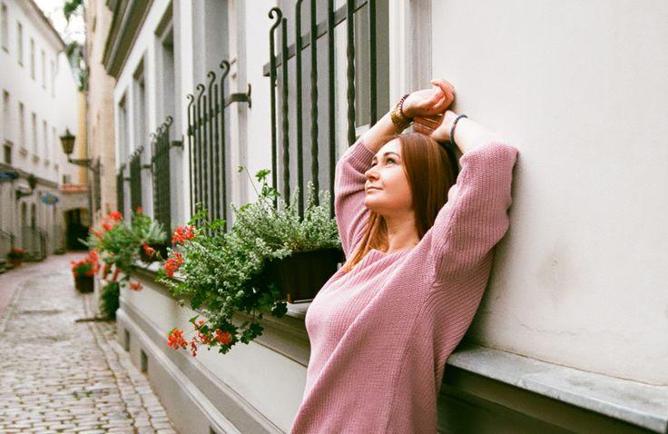 film photography, Riga old city, portrait, oman, wall, window, flowers