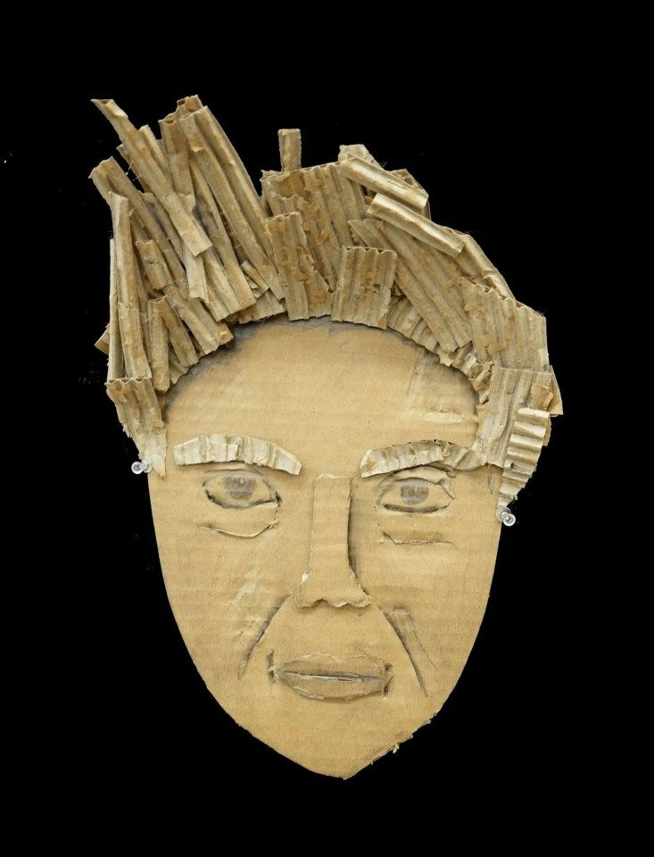 Cardboard portraits by 12th graders all about