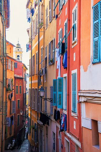 Nice - Colourful Alley    Washing hangs from colourful apartments in the old town area of Nice, France.
