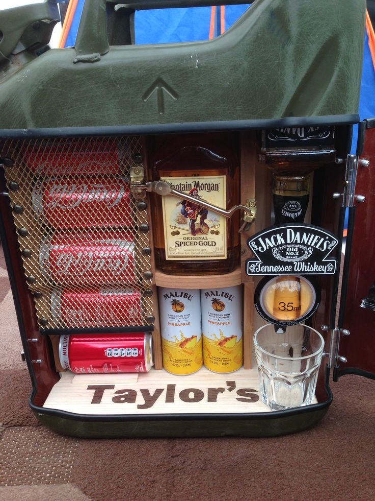 I made this jerry can mini bar from a 1997 army jerry can. I backed it with pine and the frame is made from a darker wood.