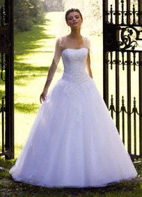 Look like you just walked out of a fairy-tale in this breathtaking tulle ball gown. Fitted strapless bodice is the perfect contrast to the full tulle skirt. Lace embellisments add texture and dimension to this whimsical style. Sweep train.  Sample Sale gowns are only available online (not available in stores).  Sample Sale gowns contain imperfections such as tears in the lining or tulle, or imperfect seams in the skirt, etc.  Specific imperfections are not visible in the photograph shown ...