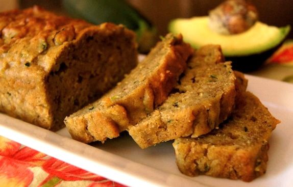 """Avocado Zucchini Bread With Olive Oil (makes two 7"""" loaves): 1/4 cup, plus 2 tablespoons olive oil   1/2 cup granulated sugar   1 tablespoon vanilla extract   2/3 cup very ripe, puréed avocado   2 eggs   2 cups grated zucchini, drained   2 cups all-purpose flour   1/2 teaspoon baking powder   1/2 teaspoon baking soda   1/2 teaspoon salt   1-1/4 teaspoons cinnamon   3/4 teaspoon all spice"""