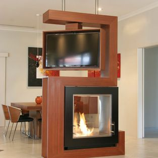 Rotating Tv Design Ideas. Want it open to one side...would rather have it wider and more storage instead of fireplace, for basement