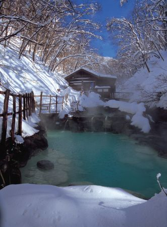 Go to an onsen (hot spring). There are many across Japan. This one isYamagata Zao Onsen, Yamagata