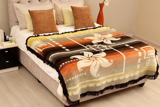 New Sesli Lily frill blanket in a pretty floral design