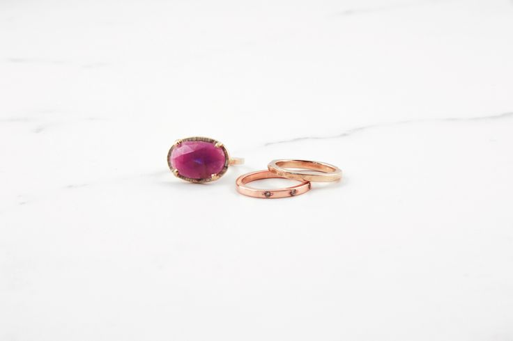 Pink sapphire and diamond gold rings