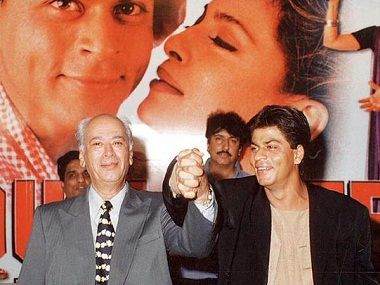 """Karan Johar became nostalgic when he shared a snap of his father Yash Johar with Shah Rukh Khan and called it """"memories forever""""."""