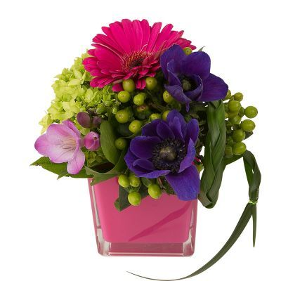 Pink Pizazz - Yes, those are purple anenomes! They are designed with freesia, hypericum, gerbera and hydrangea in a glossy pink glass cube vase.