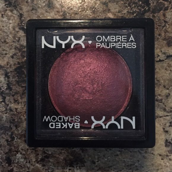 NYX Baked Shadow Purple/Burgundy eye shadow by NYX, only used 2 times.  Beautiful color and pigmentation, I'm just to white for it. Lol NYX Makeup Eyeshadow