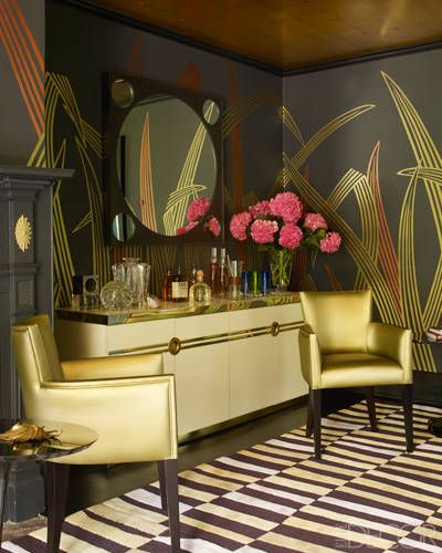 As an hostess who loves to entertain, I view the bar area an essential part of the home. I am also loving this modern twist on eclectic glamour. The gold ceiling, gold accents, and grey wallpaper with metallic moments are truly a winning combination.