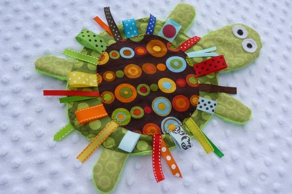 crinkle and ribbon learning sensory toy...if i was craftier maybe i'd attempt to make this. it's cute :)