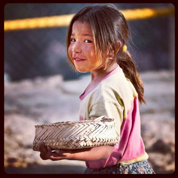 Niña Tarahumara. Chihuahua, Mexico.    I have these baskets all over my kitchen.  Their fingers get bent from making baskets all day for their entire lives.