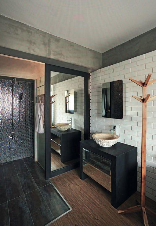the mirrored sliding door in the master bathroom bath