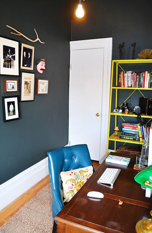 The Baker desk and pharmacy lamp were flea market finds, the chair is from TJ Maxx, and the crewel embroidered pillow was made by my namesake, Sally. The shelving is from CB2 and holds Charlie's various old film cameras. The paint is Farrow and Ball's Studio Green.