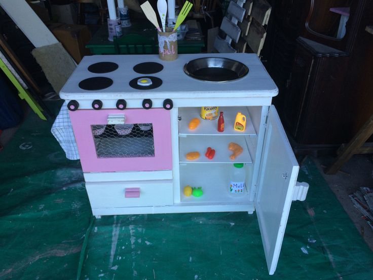 Small kitchen with fridge and sink!