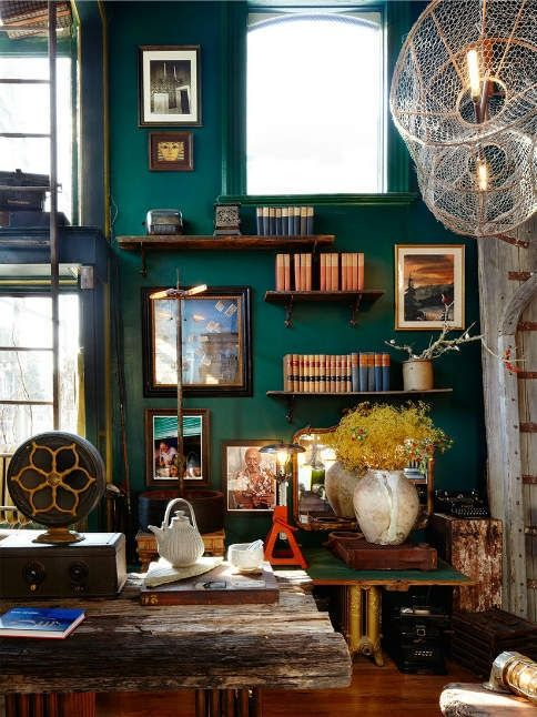 Industrial and books and jewel tones. This is my kind of room.