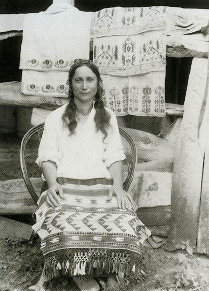 A Tatar woman with rugs with Tatar&Turkic motifs. 20th Century, Crimea