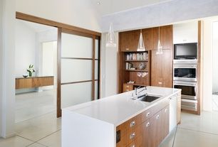 Asian Kitchen with Bamboo cabinetry, Pendant light, Undermount sink, Flush, European Cabinets, Kitchen island, Concrete tile