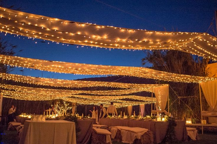 The dinner area : million light bulbs on drapes!