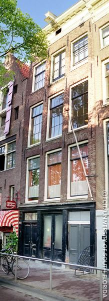 "The house where Anne Frank and her family hid is located at 23 Prinsengracht in Amsterdam. The ""Secret Annex"" is located at the back of the house."