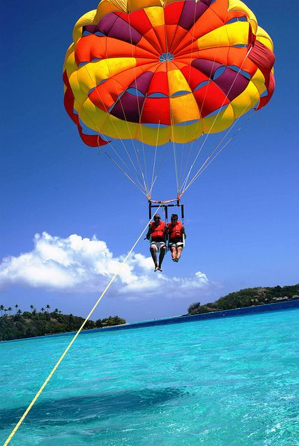 Although I would be scared, I would parasail over the island.