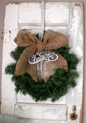 Wreath with burlap bow. (Minus the merry christmas sign) would be cute on the wreaths hanging on each side of the alter!