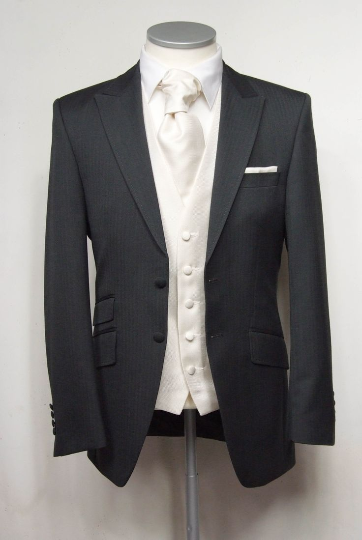 """Grey herringbone grooms lounge suit. Choose from our wide range of wedding waistcoat's in a variety of styles. Mens sizes from 32"""" chest upward and include extra short, short, regular, long and extra long fittings. Boys sizes from 20"""" chest to 34"""" chest. Complete outfit includes jacket, trousers, hire or matching waistcoat, brand new traditional or French wing shirt in white or ivory, tie or cravat, braces and cufflinks. £125.00 to hire #groom #wedding #suit #suithire #waistcoat #grey"""