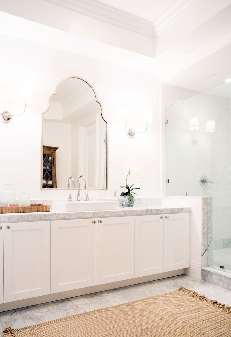 Shower drain furthermore stone look wall tile additionally modern - Basement Spa Bathroom With Marble Floors And Quatrefoil Tile Shower By Studio Mcgee