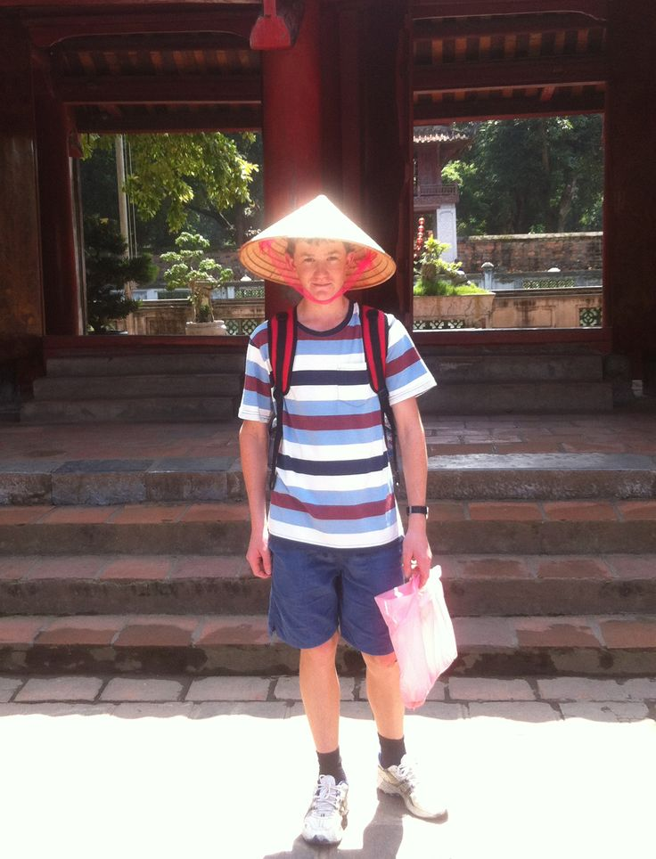 Wearing the traditional non la (conical hat). Awesome sun protection! #VietnamSchoolTours