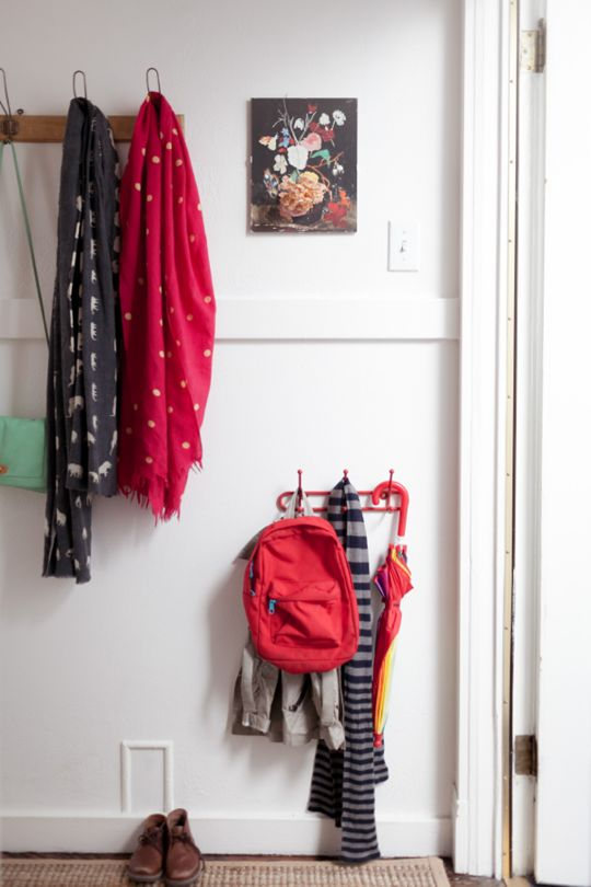 Wall mounted storage & hooks for a low profile entry.