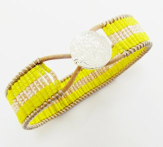 woven glass bead bracelet: Woven glass beads on leather cord with sterling silver closure. $108
