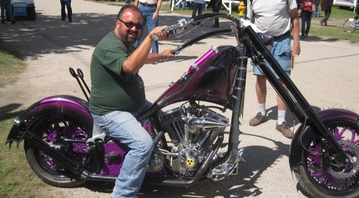 Frank Fritz, 'American Pickers' co-star is also a bike enthusiast posing on one of his bikes.