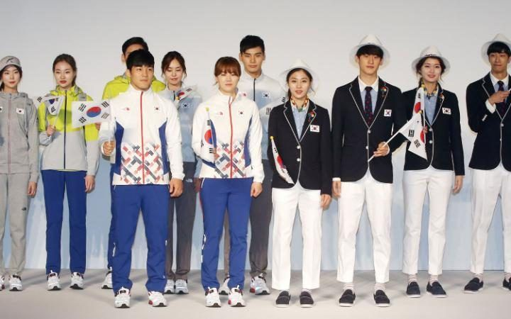 South Korean Olympic athletes and models show the South Korean Olympic team uniforms for the 2016 Rio Olympic Games at the Korean National Training Center in Seoul.