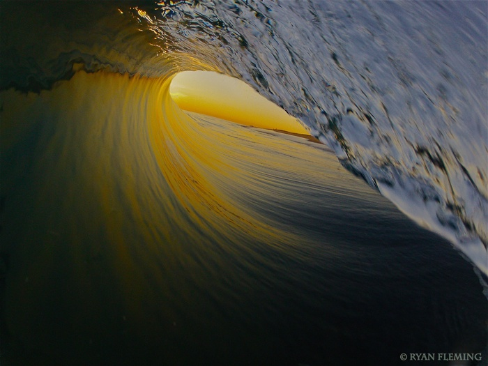 This is a photo from Surfline.  The photographer is Ryan Fleming.  I love the early morning color and the perfection of the tube.  Great Photo
