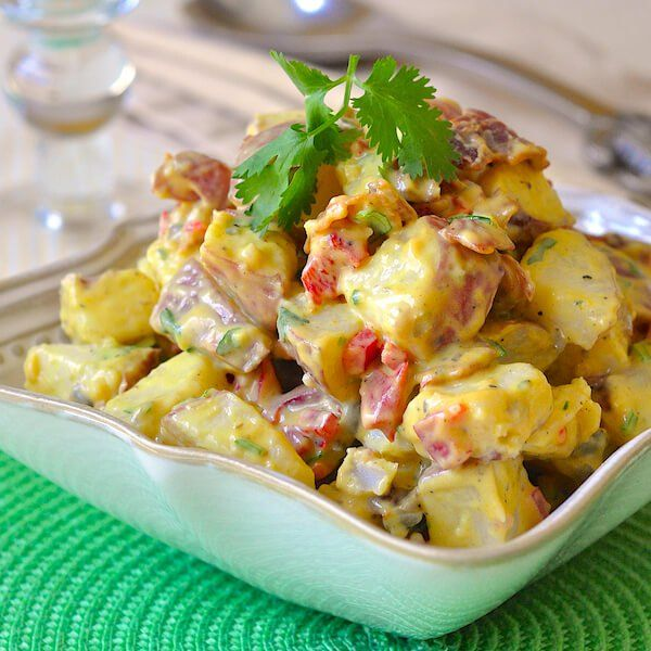This satisfying bacon potato salad with a sweet and tangy mustard dressing borrows the best elements from a few of my all time favorite potato salad recipes