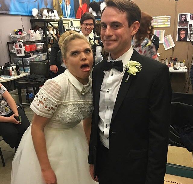 This has to after their actual wedding because there is no sketch that matches this description. I'm guessing they had a taping after their wedding and Jason was Matt's best man but he needed to have a wig on for the sketch and decided to photobomb with it on still in his tux.