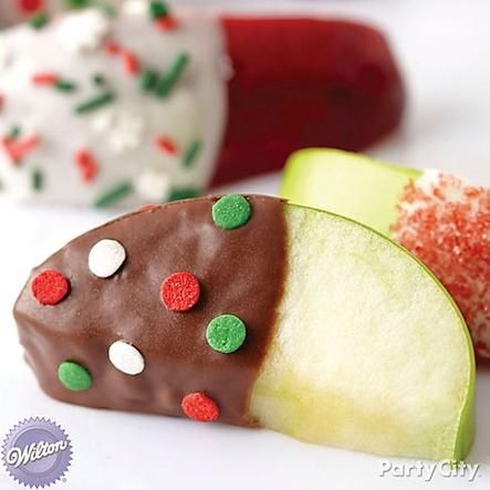 For a tasty treat that's not too sweet, set out apple slices dipped in melted candy and sprinkles. Click for more yummy melted candy Christmas treat ideas!