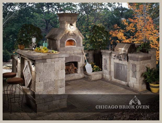 Outside kitchen with pizza oven!  i plan to build one of these for myself one day!!! I wish we still had ours.
