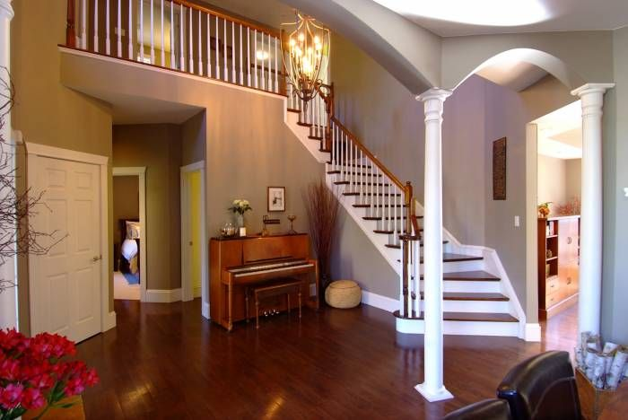 Homes for sale in Carp - Foyer The soaring ceiling stretches across the expanse of the open vestibule.  The curved staircase leads to the upper level balcony that overlooks the welcoming area.  There is an oversized closet for guests and rich hardwood floors. MLS#887857