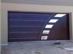 Modern garage door, perfect for contemporary style houses www.garagedoor4less.com