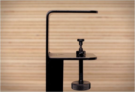 Have an old door, tabletop or plank of wood laying around at home or at the office? Why not turn that flat surface into a table? The ingenious Floyd Leg is a set of four clamp-on steel legs, that turn any flat surface into a table. It is also the ide
