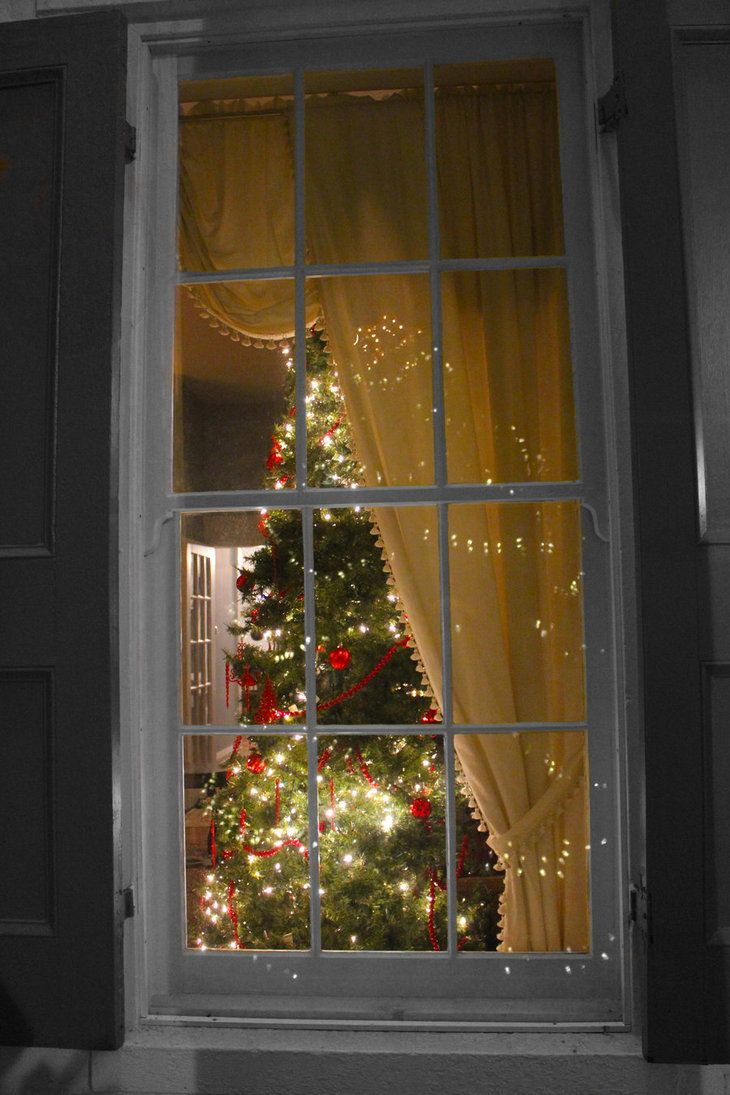 Love the idea of taking a photo from the outside in. A little face peeking out the window would make for a cute Christmas card