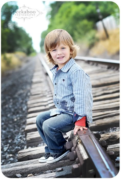 sitting on the railroad track. adorable.                 ~until he gets hit by a train